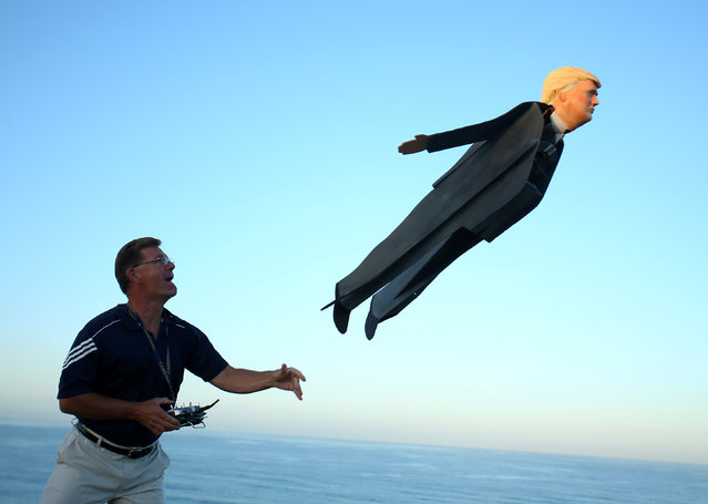 Remote control plane builder Otto Diefffenbach III launches his plane resembling U.S. Presidential candidate Donald Trump in Carlsbad, California, U.S. September 15, 2016. (Photo by Mike Blake/Reuters)
