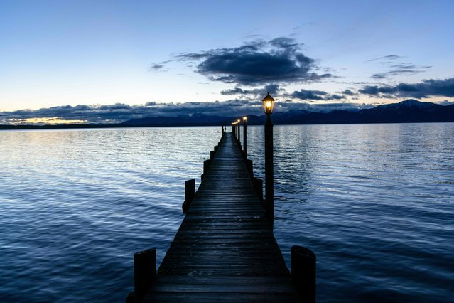 A picture taken on January 5, 2018 shows a pier over the Chiemsee lake in Seeon-Seebruck in southern Bavaria. (Photo by Matthias Balk/AFP Photo/DPA)