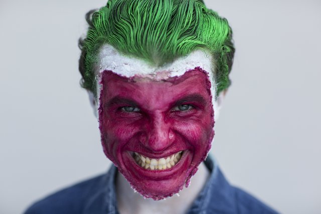 Coty Clark attends New York Comic Con dressed as DC Comics' The Joker in Manhattan, New York, October 8, 2015. (Photo by Andrew Kelly/Reuters)