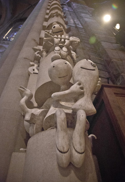 """Sculptures by Tom Otterness are installed within the support columns at the Cathedral of St. John the Divine, among the works of 30 artists in the multimedia exhibition """"The Value of Food: Sustaining a Green Planet"""", Wednesday, October 7, 2015, in New York. The exhibition, installed in the cathedral's seven chapels and 14 bays, explores food accessibility, sustainability and other food-related issues and runs through April 3, 2016.  (Photo by Bebeto Matthews/AP Photo)"""