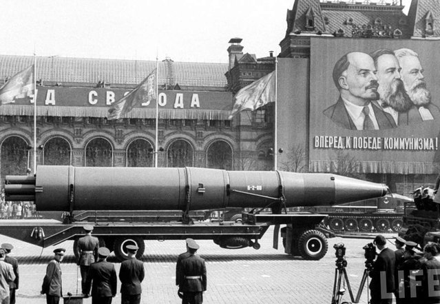 In this May 1, 1963 file photo, a Naval rocket is exhibited in Moscow's Red Square past a banner of Vladimir Lenin, Friedrich Engels and Karl Marx during the annual May Day parade in the Soviet Union. Under the shadow of the Cold War's threat of 'mutually assured destruction,  1963 was the year of dawning arms control between the U.S. and the Soviet Union; they signed a Nuclear Test Ban Treaty. (Photo by AFP Photo/Life)