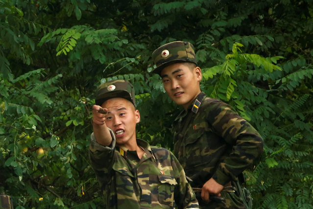North Korean soldiers keep watch at the bank of the Yalu River, near the North Korean town of Sinuiju, opposite Dandong in China's Liaoning province, September 10, 2016. (Photo by Thomas Peter/Reuters)