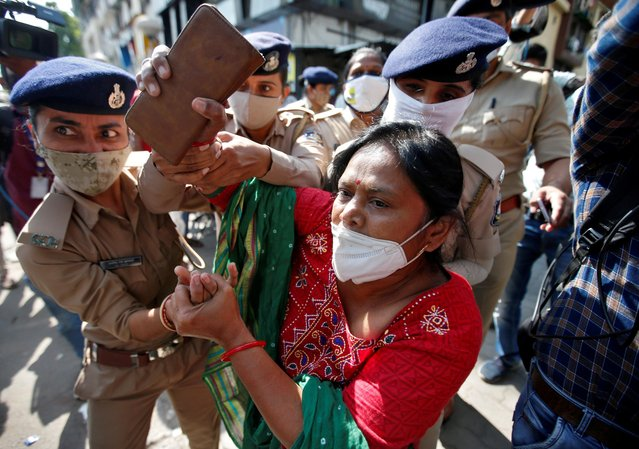 A supporter of India's main opposition Congress party is detained by police during a protest after the death of a rape victim, in Ahmedabad, India, October 7, 2020. (Photo by Amit Dave/Reuters)
