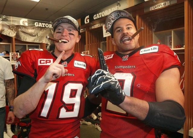 Calgary Stampeders' quarterback Bo Levi Mitchell (L) and Jon Cornish celebrate in the locker room after the Stampeders defeated the Hamilton Tiger Cats in the CFL's 102nd Grey Cup football championship in Vancouver, British Columbia, November 30, 2014. (Photo by Todd Korol/Reuters)