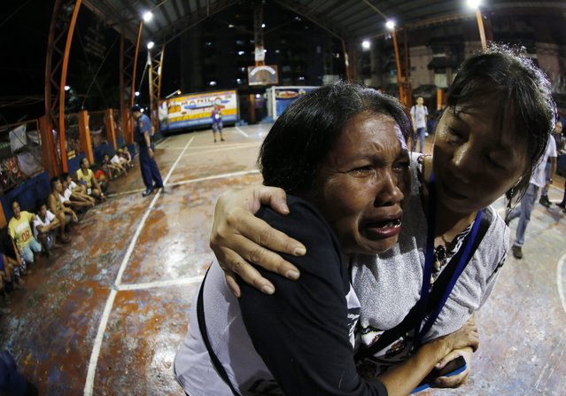 A picture made available on 01 October 2016 shows a Filipino woman in tears during a drug buy-bust operation at a slum area in Manila, Philippines, 30 September 2016. (Photo by Francis R. Malasig/EPA)