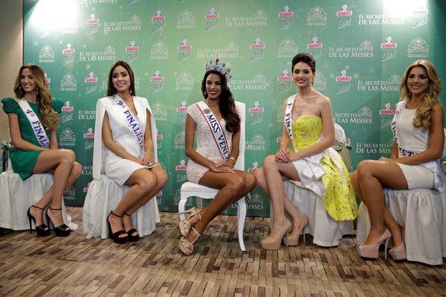 Miss Venezuela 2016 Keysi Sayago (C) attends a news conference next to (L-R) fourth runner-up Rosangelica Piscitelli, second runner-up Antonella Massaro, first runner-up Diana Croce, and third runner-up Reneta Bello in Caracas, Venezuela October 6, 2016. (Photo by Marco Bello/Reuters)