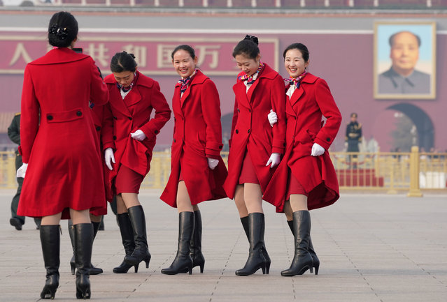 Hotel ushers pose for a photo at Tiananmen Square as delegates attend the second plenary session of the National People's Congress (NPC) in Beijing, China, March 9, 2018. (Photo by Jason Lee/Reuters)