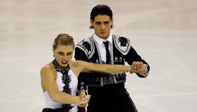 Canada's Piper Gilles and Paul Poirier perform during the Ice Dance short program at the ISU Grand Prix of Figure Skating final in Barcelona December 12, 2014. (Photo by Albert Gea/Reuters)