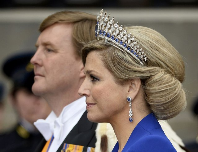 Dutch King Willem-Alexander and his wife Queen Maxima leave Nieuwe Kerk church after the religious crowning ceremony in Amsterdam April 30, 2013. Queen Beatrix of the Netherlands abdicated on Tuesday, handing over to her eldest son, Willem-Alexander, who became the first King of the Netherlands in over 120 years. (Photo by Dylan Martinez/Reuters)