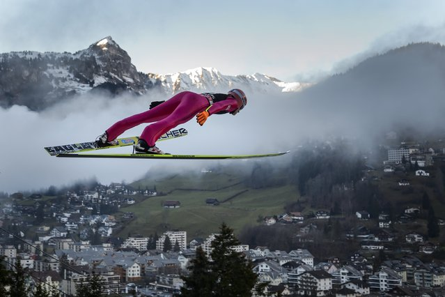 Poland's Dawid Kubacki soars through the air during the men's FIS Ski Jumping World Cup competition in Engelberg, central Switzerland, on December 20, 2014. (Photo by Fabrice Coffrini/AFP Photo)