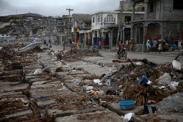 People walk down the street after Hurricane Matthew hit Jeremie, Haiti, October 15, 2016. (Photo by Carlos Garcia Rawlins/Reuters)