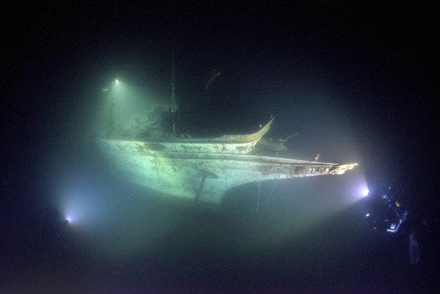 """""""I've never seen anything like it in all my years of shipwreck diving. For me it was almost surreal being there. I'd dreamed of seeing this shipwreck and it took years of experience both in diving and photography to be able to safely capture the images I saw in my mind"""". (Photo by Becky Kagan Schott/Caters News Agency)"""