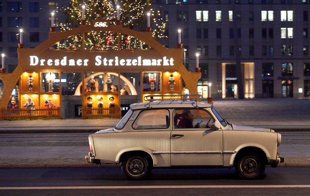 A GDR Trabant car drives through the city during the local coronavirus disease (COVID-19) lockdown in Dresden, Germany, December 14, 2020. (Photo by Matthias Rietschel/Reuters)
