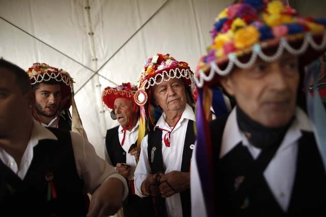 Men in traditional costumes look on before competing in the 53rd Verdiales music contest in Malaga, southern Spain December 28, 2014. (Photo by Jon Nazca/Reuters)