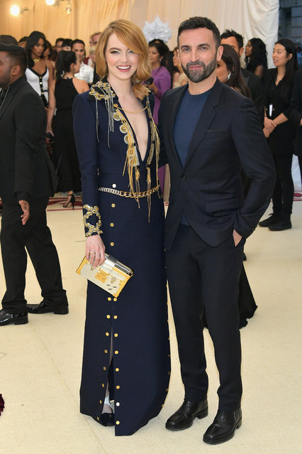 Emma Stone and designer Nicolas Ghesquiere attend the Heavenly Bodies: Fashion & The Catholic Imagination Costume Institute Gala at The Metropolitan Museum of Art on May 7, 2018 in New York City. (Photo by Neilson Barnard/Getty Images)