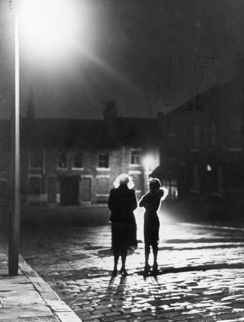 30th October 1979:  Prostitutes still ply their trade under the glare of the street lamps, but the police are never far away.  (Photo by Evening Standard/Getty Images)