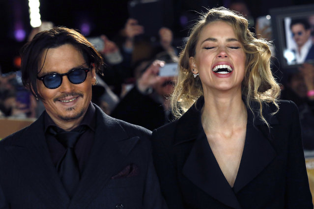 """Johnny Depp and Amber Heard laugh as they arrive for the UK premiere of """"Mortdecai"""" at Leicester Sqaure in London, January 19, 2015. (Photo by Luke MacGregor/Reuters)"""