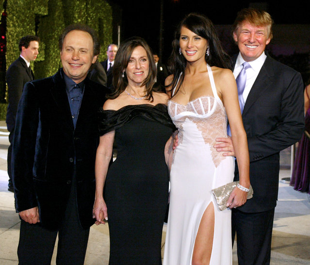 From left, Billy Crystal, host of the 76th annual Academy Awards, his wife Janice Goldfinger, Melania Knauss and her boyfriend Donald Trump, pose together as they leave the Vanity Fair Oscar party at Morton's restaurant in West Hollywood, California, early March 1, 2004. (Photo by Ethan Miller/Reuters)