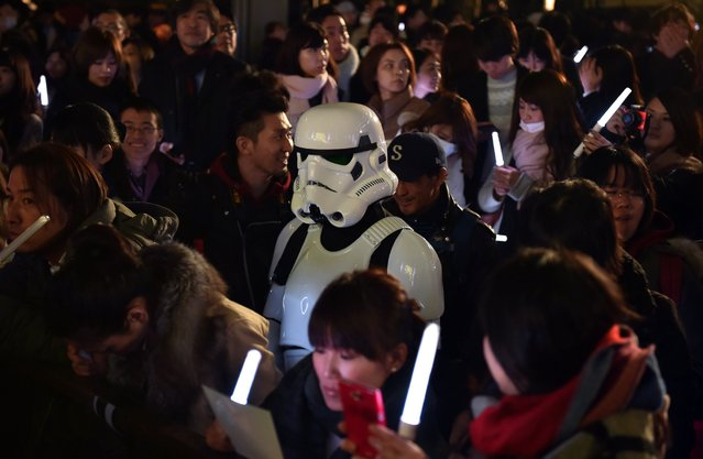 A fan dressed as a Stormtrooper is seen amid other fans as they gather for a promotional event for the upcoming Star Wars film in Tokyo on December 10, 2015. (Photo by Kazuhiro Nogi/AFP Photo)