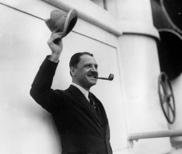 """British novelist and playwright W. Somerset Maugham waves farewell as he leaves from New York for Europe aboard the ocean liner Aquitania, on May 22, 1923. Maugham's play """"Rain"""" is having a successful run on New York City's Broadway. (Photo by AP Photo)"""