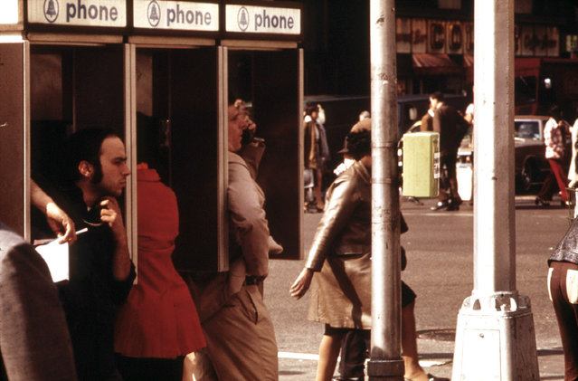 Public pay phone stalls in use at Broadway and 34th Street, in May of 1973. The first handheld mobile phone call in history was made one month prior to this photo, in midtown Manhattan, in April 1973, when Martin Cooper, a Motorola researcher made a call to his chief competitor Dr. Joel S. Engel, head of Bell Labs. (Photo by Erik Calonius/NARA via The Atlantic)