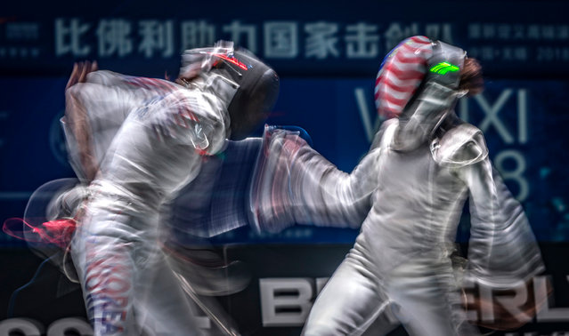Hee Sook Jeon (L) of South Korea competes against Lee Kiefer (R) of USA in the team women's Foil qualification match at the Fencing World Championships in Wuxi, China, 26 July 2018. (Photo by Aleksandar Plavevski/EPA/EFE)