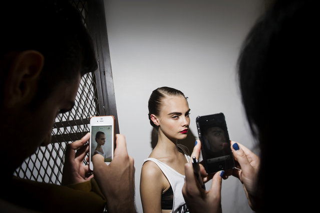 """September 2012, NYC, NY – Model Cara Delevingne is photographed with iphones by her fans backstage at Jason Wu. From the series """"Fashion Lust"""". (Photo by Dina Litovsky)"""