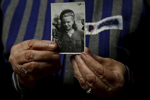 Auschwitz death camp survivor Jadwiga Bogucka (maiden name Regulska), 89, registered with camp number 86356, holds a picture of herself from 1944 in Warsaw, Poland January 12, 2015. (Photo by Kacper Pempel/Reuters)