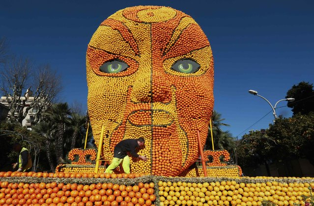 "A worker puts the final touches to a replica of a Beijing opera mask made with lemons and oranges during the 82th Lemon festival in Menton February 12, 2015. Over 20,000 hours work for teams to set up the festival and some 145 metric tons of lemons and oranges are used to make displays during the 82th festival, which is themed ""Tribulations of a lemon in China"", and runs from February 14 through March 4. (Photo by Eric Gaillard/Reuters)"