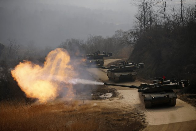 A South Korean army K-2 tank fires during an annual live-fire military exercise in Yangpyeong February 11, 2015. (Photo by Kim Hong-Ji/Reuters)
