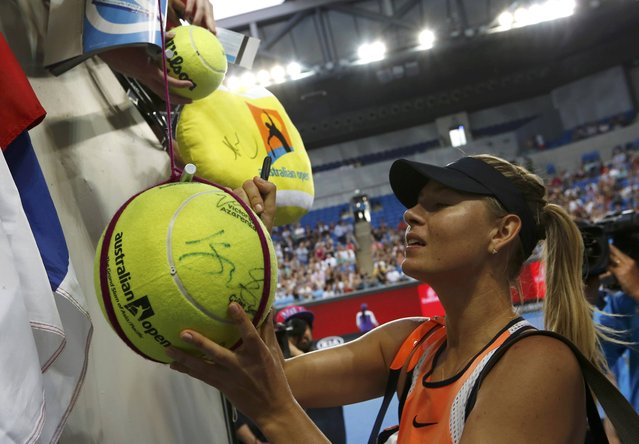 Russia's Maria Sharapova signs autographs after winning her first round match against Japan's Nao Hibino at the Australian Open tennis tournament at Melbourne Park, Australia, January 18, 2016. (Photo by Thomas Peter/Reuters)