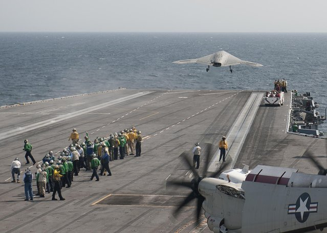 An X-47B Unmanned Combat Air System (UCAS) demonstrator launches from the aircraft carrier USS George H.W. Bush (CVN 77) after completing its first arrested landing on the flight deck of an aircraft carrier. The landing marks the first time any unmanned aircraft has completed an arrested landing at sea. George H.W. Bush is conducting training operations in the Atlantic Ocean. (Photo by Mass Communication Specialist 3nd Class Christopher A. Liaghat/U.S. Navy)