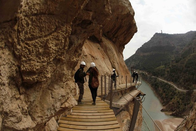 Journalists walk along the new Caminito del Rey (The King's Little Pathway) in El Chorro-Alora, near Malaga, southern Spain March 15, 2015. (Photo by Jon Nazca/Reuters)