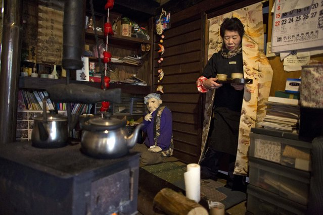 Tsukimi Ayano serves tea in her house in the village of Nagoro on Shikoku Island in southern Japan February 24, 2015. (Photo by Thomas Peter/Reuters)