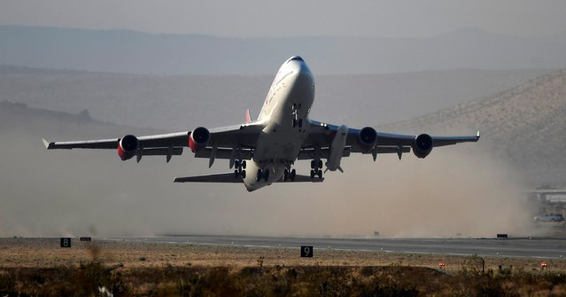 A modified Boeing 747 takes off carrying Virgin Orbit's LauncherOne rocket, in Mojave, California, U.S., June 30, 2021. (Photo by Gene Blevins/Reuters)