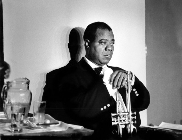 Louis Armstrong, Paris, 1960. (Photo by Herman Leonard)