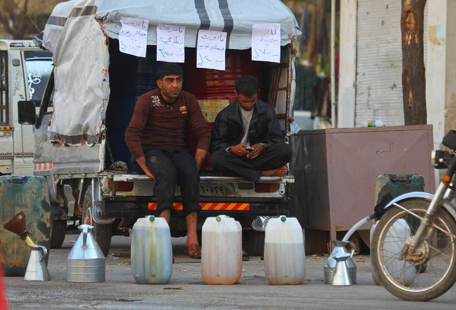 Street vendors sit on a pick-up truck as they sell diesel and gasoline in the rebel-controlled city of Idlib, Syria November 7, 2015. (Photo by Ammar Abdullah/Reuters)