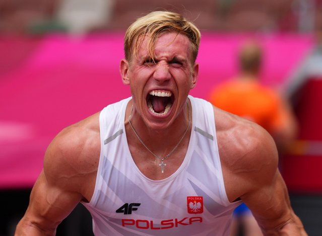 Poland's Piotr Lisek reacts after competing in the men's pole vault qualification during the Tokyo 2020 Olympic Games at the Olympic Stadium in Tokyo on July 31, 2021. (Photo by Aleksandra Szmigiel/Reuters)