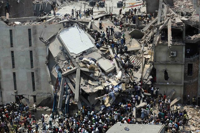 People rescue garment workers trapped under rubble at the Rana Plaza building after it collapsed, in Savar, 30 km (19 miles) outside Dhaka April 24, 2013. (Photo by Andrew Biraj/Reuters)