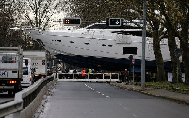 The yacht Princess 98  is carried by a truck to the fairground in Duesseldorf, Germany, Monday, January 6, 2014. The Princess  98 with a length of 30 meter (90ft) weighs 100 tons and will be on display at the international boat fair in Duesseldorf from Jan. 18 until Jan. 26th. The price will be around 7 million euro (9.5 million US dlrs). (Photo by Frank Augstein/AP Photo)