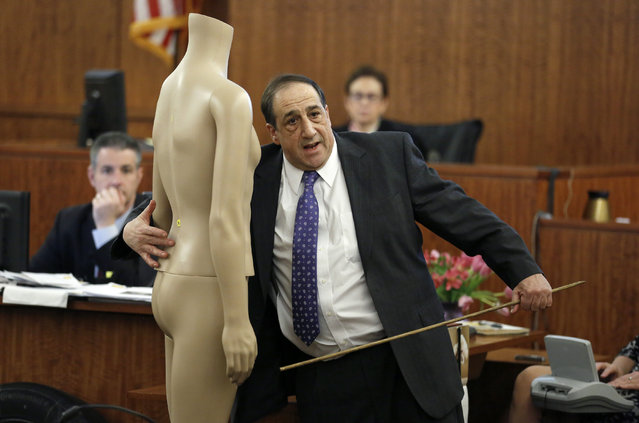 William Zane, of the Massachusetts state medical examiner's office, points to a mannequin, while testifying about the location of bullet wounds in the body of victim Odin Lloyd during the murder trial for former New England Patriots NFL football player Aaron Hernandez, Thursday, April 2, 2015, in Fall River, Mass. Hernandez is charged with killing Lloyd. Zane performed an autopsy on Lloyd's body. (Photo by Steven Senne/AP Photo)