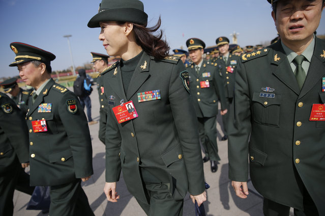 Military delegates arrive for the second plenary session of the National People's Congress (NPC) in Beijing, China, March 9, 2016. (Photo by Damir Sagolj/Reuters)