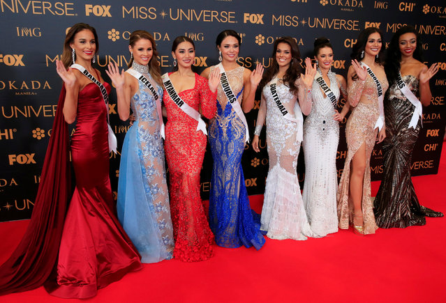 Miss Universe candidates gestures for a picture during a red carpet inside a SMX convention in metro Manila, Philippines January 29, 2017. In Photo from L-R: Miss Barbados Shannon Harris, Miss Iceland Hildur Maria Leifsdottir, Miss Myanmar Htet Htet Htun, Miss Honduras Sirey Moran, Miss Guatemala Virginia Argueta, Miss Great Britain Jaime-Lee Faulkner, Miss Indonesia Kezia Warouw and Miss Bahamas Cherell Williamson. (Photo by Romeo Ranoco/Reuters)