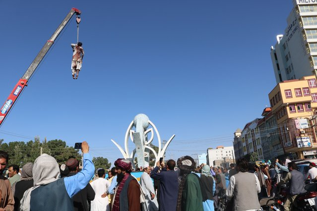 A dead body hangs from a crane in the main square of Herat city in western Afghanistan, on Saturday, September 25, 2021. (Photo by AP Photo/Stringer)