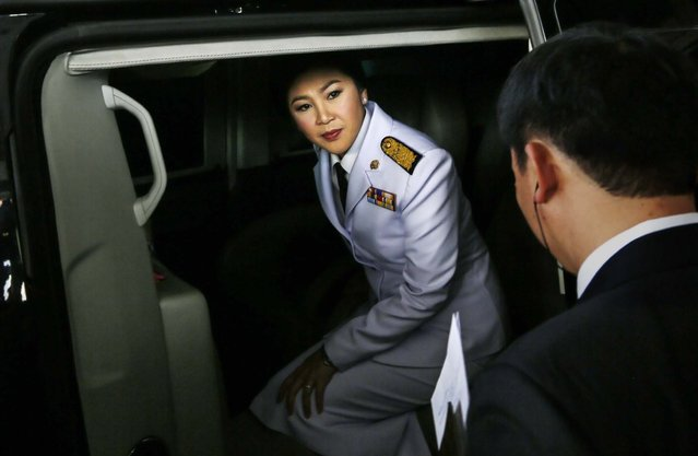 Thailand's Prime Minister Yingluck Shinawatra gets in her car to leave following a meeting with election commissioners at the Army Club in Bangkok, on January 28, 2014. Thailand's government announced Tuesday it will go ahead with an election this weekend despite months of street protests and an opposition boycott. (Photo by Wally Santana/Associated Press)