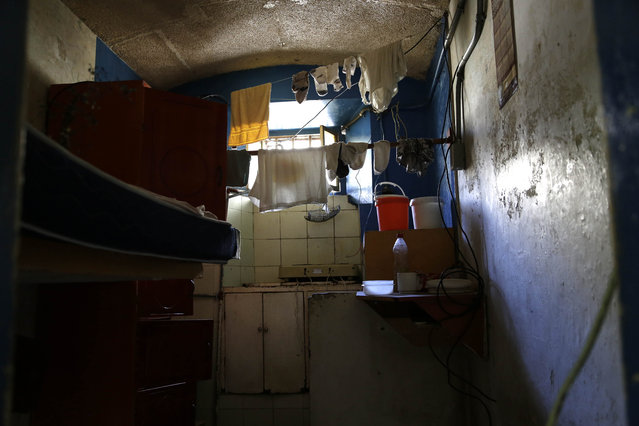 This April 9, 2015 photo shows the inside of a jail cell with personal items left behind by inmates who were transferred away from the now empty Garcia Moreno Prison, during a guided tour for the public in Quito, Ecuador. This cell with two beds was designed to hold just two prisoners, but up to eight people used the room at one time. It measures about eight square meters (86 square feet). (Photo by Dolores Ochoa/AP Photo)