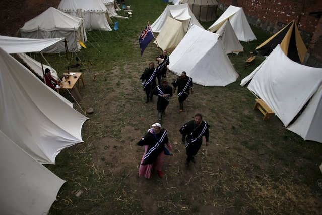 Members of the New Zeland team walk to take part in the opening ceremony parade of the Medieval Combat World Championship at Malbork Castle, northern Poland, April 30, 2015. (Photo by Kacper Pempel/Reuters)