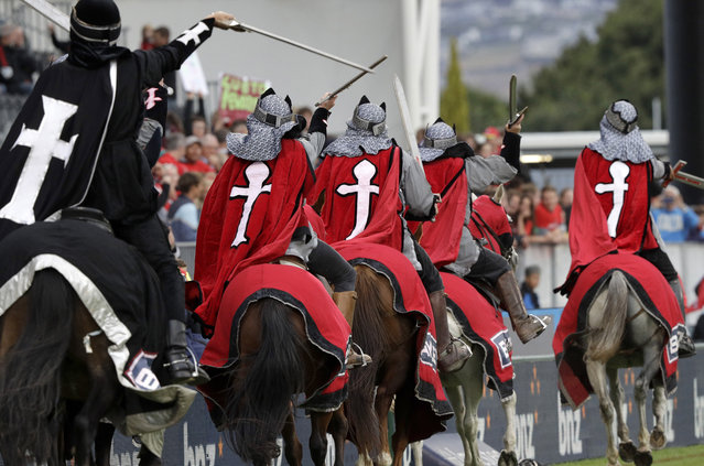 """In this February 23, 2019, photo, the Crusader horseman ride around the arena prior to the start of the Super Rugby match between the Crusaders and Hurricanes in Christchurch, New Zealand. The Crusaders announced Wednesday, April 3, 2019, that they will be considering a change to their name and branding following the Christchurch terrorist attacks on March 15 – insisting the status quo is """"no longer tenable"""". (Photo by Mark Baker/AP Photo)"""