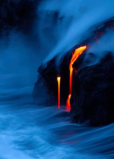 Lava from the Kilauea Volcano flows into the ocean in Kapalana, Hawaii in a picture taken by Stephen King. (Photo by Stephen King/Travel Photographer of the Year)