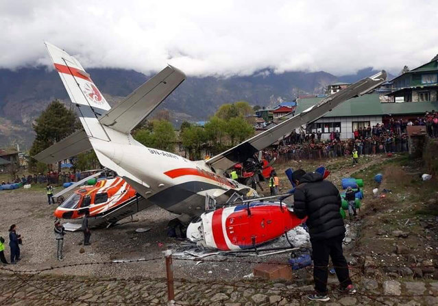 A view of the crash site of a domestic Summit Air aircraft and a helicopter at Lukla Airport, Solukhumbu district, Nepal, 14 April 2019. (Photo by Ram Nepal/EPA/EFE)